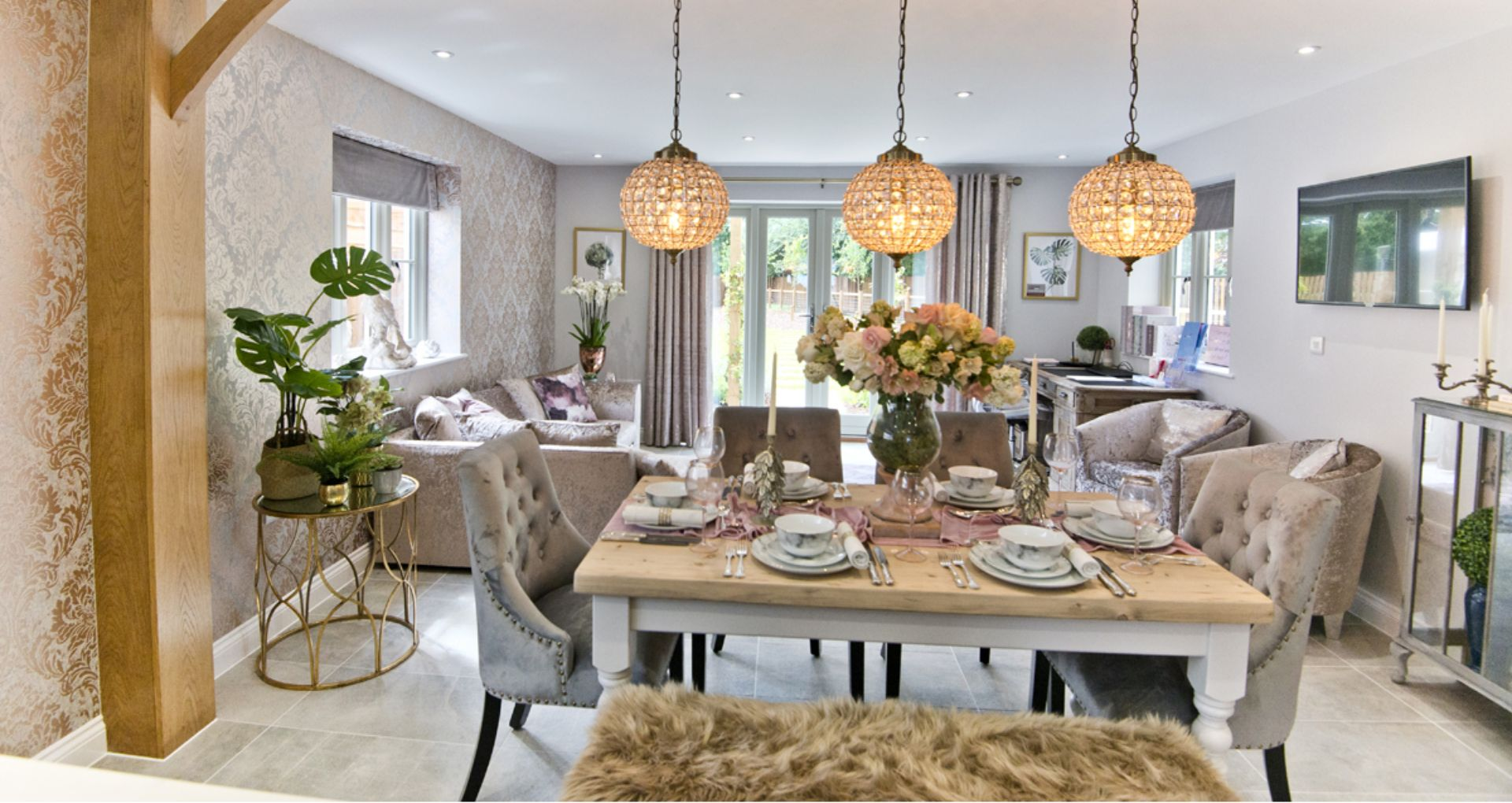 Bright living room with french doors at the back leading into the garden